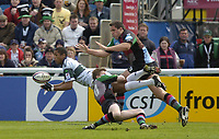 Photo: Alan Crowhurst, Digitalsport<br /> <br />  NEC Harlequins v London Irish, Zurich Premiership, 09/04/2005. Delon Armitage of Irish gets the ball away before being hammered by Tony Diprose of Quins.