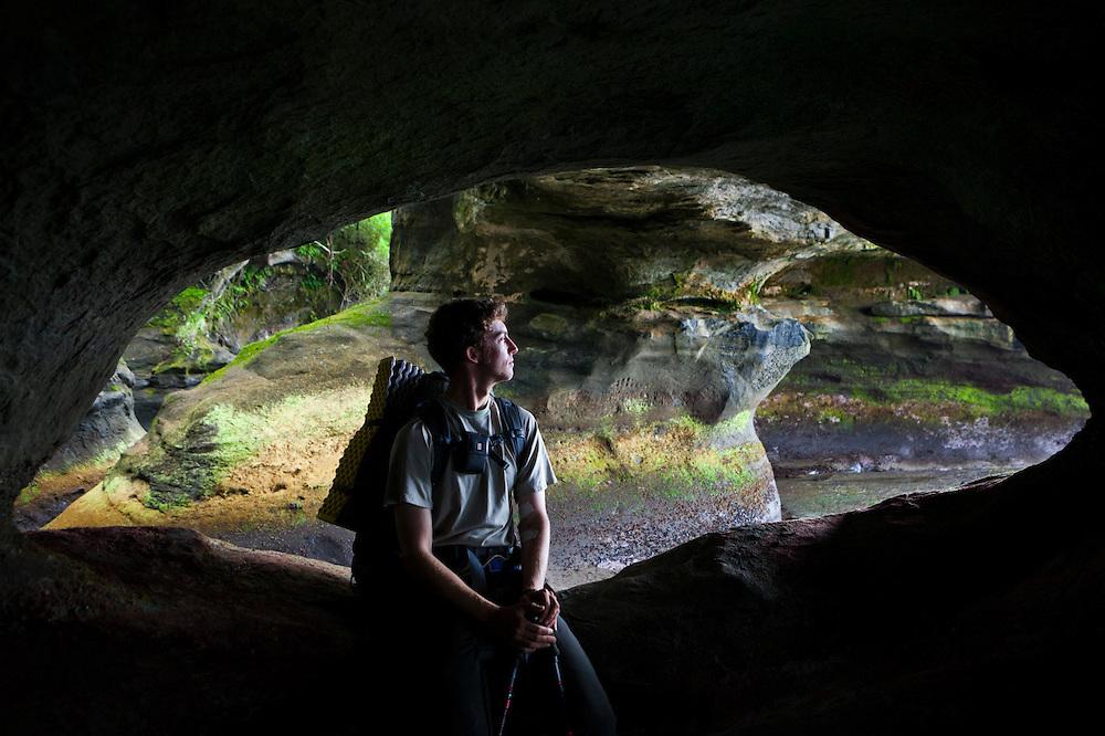 Zach Podell-Eberhardt in a sea cave near Owen Point, West Coast Trail, British Columbia, Canada.