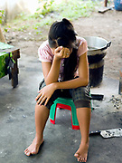 Young woman with her head resting on her hand at a shelter for victims of trafficking and sexual exploitation in Vientiane, Lao PDR. In addition to providing holistic care and recovery for those rescued, AFESIP (Agir pour les Femmes en Situation Precaire / Acting for Women in Distressing Situations) offers social enterprise-based vocational training to support sustainable community reintegration.