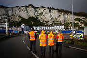 P&O ferry staff wait to access the port as tensions are high between police and drivers who have been waiting over 48 hours for the Port of Dover to re-open, on the 23rd of December 2020, Dover, Kent, United Kingdom. The French border was closed due to a new strain of COVID-19 all travellers are now waiting to receive a COVID-19 test before they can board a ferry to Calais, France. Dover is the nearest port to France with just 34 kilometres (21 miles) between them. It is one of the busiest ports in the world. As well as freight container ships it is also the main port for P&O and DFDS Seaways ferries.  (photo by Andrew Aitchison / In pictures via Getty Images)