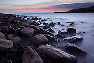 The last glimmers of light over Kimmeridge Bay, Dorset