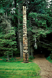 AK: Alaska Sitka National Historic Park, totem pole in rain forest  .Photo Copyright: Lee Foster, lee@fostertravel.com, www.fostertravel.com, (510) 549-2202.Image: aksitk204