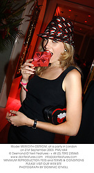 Model MEREDITH OSTROM, at a party in London on 21st September 2003. PMU 644