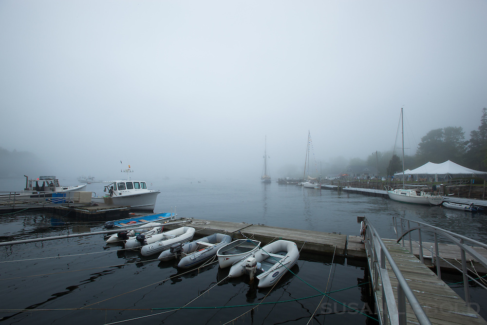 Boats at a pier on a foggy morning in Maine.