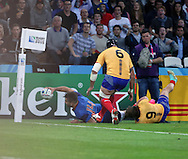 Sofiane Guitoune (France) scoring France's first try of the match to take the score F10 R3 during the Rugby World Cup Pool D match between France and Romania at the Queen Elizabeth II Olympic Park, London, United Kingdom on 23 September 2015. Photo by Matthew Redman.