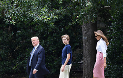 President Donald Trump, Barron Trump and Melania Trump depart the White House in Washington, DC, on June 30, 2017. Photo by Olivier Douliery/ Abaca