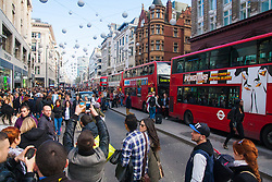 th 2014. Tens of thousands of shoppers flood central London as  Black Friday discounts and most people's pay days kick off the Christmas shopping season in earnest. PICTURED: Buses queue on Oxford Street as up ahead a protest brings traffic to a standstill.