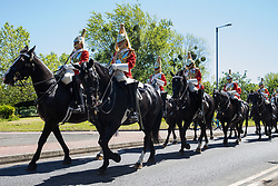 Windsor, UK. 9th June, 2021. The Household Cavalry Mounted Regiment proceeds towards Combermere Barracks following a dress rehearsal at Windsor Castle for Trooping the Colour. A socially distanced and scaled down Trooping the Colour ceremony to mark the Queen's birthday will take place at Windsor Castle on 12th June incorporating many of the elements from the annual ceremonial parade on Horse Guards, with F Company Scots Guards Trooping the Colour of the 2nd Battalion Scots Guards in the Castle Quadrangle.