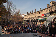 Male Kayserians gather at the Ulu Camii mosque in Kayseri's old city before Friday prayers. The industrial city is located in central Anatolia, Turkey.