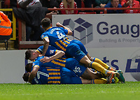 Football - 2017 / 2018 Sky Bet EFL League One - Play-Off Semi-Final, First Leg: Charlton Athletic vs. Shrewsbury Town<br /> <br /> Shrewsbury Town players smother goal scorer Jon Nolan (Shrewsbury Town FC) as he gives his team the lead at The Valley<br /> <br /> COLORSPORT/DANIEL BEARHAM