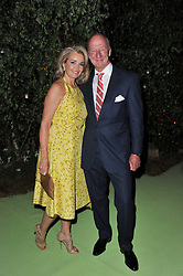 MR & MRS CASPAR MacDONALD-HALL at a dinner hosted by Cartier in celebration of the Chelsea Flower Show held at Battersea Power Station, 188 Kirtling Street, London SW8 on 23rd May 2011.