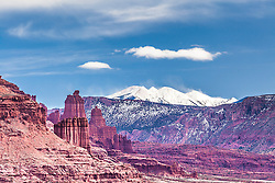 The Fisher Towers make a nice exclamation mark on the Southwest desert landscape below the toweing La Sal mountains outside Moab Utah