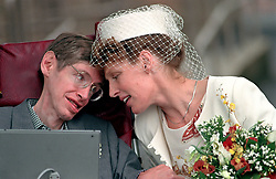 Professor Stephen Hawking with his wife Elaine Mason after their marriage ceremony at Cambridge registry office.