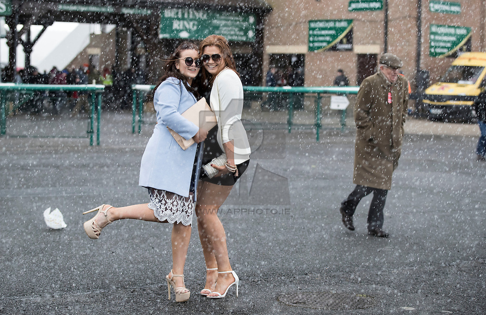 Exclusive to Irish Times Repro Free: 28/04/2016 Emer O'Dea and Lolly Doyle battle the weather to pose for the photographers at the Punchestown Racing Festival. Picture Andres Poveda