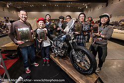 Custom builder Kenko Kimura with crew from his Heiwa Motorcycle from Hiroshima, Japan with their his custom Triumph after receiving the best of show award for at the Mooneyes Yokohama Hot Rod & Custom Show. Yokohama, Japan. December 3, 2016.  Photography ©2016 Michael Lichter.