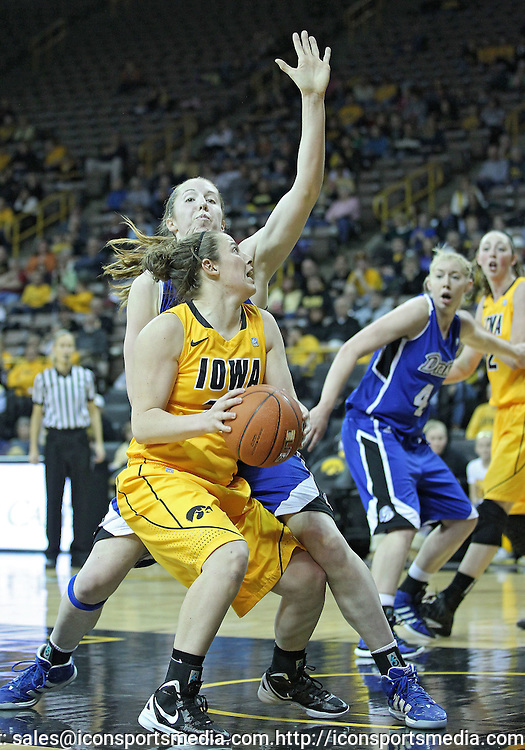 December 20, 2011: Iowa Hawkeyes guard Samantha Logic (22) eyes the basket during the NCAA women's basketball game between the Drake Bulldogs and the Iowa Hawkeyes at Carver-Hawkeye Arena in Iowa City, Iowa on Tuesday, December 20, 2011. Iowa defeated Drake 71-46.