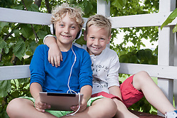 Friends young boys tree-house tablet computer