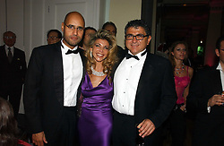 Left to right, MR SAIF GADDAFI second son of Libyan leader Colonel Gaddafi, LISA TCHENGUIZ and VINCENT TCHENGUIZ at Andy & Patti Wong's annual Chinese New year Party, this year to celebrate the Year of The Pig, held at Madame Tussauds, Marylebone Road, London on 27th January 2007.<br /><br />NON EXCLUSIVE - WORLD RIGHTS