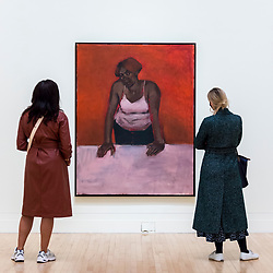 """© Licensed to London News Pictures. 02/12/2020. LONDON, UK. Visitors view """"Geranium Love Sonnet"""", 2010. Preview of """"Lynette Yiadom-Boakye: Fly In League With The Night"""" the first major UK survey exhibition by British artist Lynette Yiadom-Boakye.  Over 70 of her works spanning two decades are on display at Tate Britain.  It is the first new exhibition at Tate since the galleries were re-opened after coronavirus lockdown restrictions were slightly eased by the UK government.  Photo credit: Stephen Chung/LNP"""