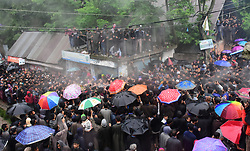 May 24, 2019 - Srinagar, Kashmir - Kashmiri people carry the dead body of top rebel leader Zakir Musa during heavy rainfall in Noorpura area of Pulwama District, Indian Administered Kashmir on 24 May 2019. Musa was killed in an overnight encounter with Indian Governmnet Forces in Dadsara Village of pulwama ditrict. Musa was associated with Al-Qaida wing in Kahsmir and was the head of self formed rebellion group Ansar Gazwatul Hind. (Credit Image: © Muzamil Mattoo/NurPhoto via ZUMA Press)