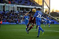 Bradford City's Paul Caddis (38) and Peterborough United defender Tyler Denton (23) challenge at the back post during the EFL Sky Bet League 1 match between Peterborough United and Bradford City at The Abax Stadium, Peterborough, England on 17 November 2018.