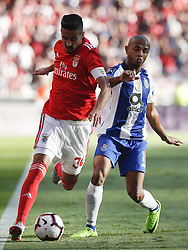October 7, 2018 - Lisbon, Portugal - Andre Almeida of Benfica (L) vies for the ball with Yacine Brahimi of Porto (R)  during the Portuguese League football match between SL Benfica and FC Porto at Luz Stadium in Lisbon on October 7, 2018. (Credit Image: © Carlos Palma/NurPhoto/ZUMA Press)