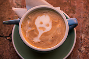 A cafe latte with a ghost design made from the foamed milk during the Dia de Muertos festival in San Miguel de Allende, Mexico.