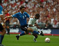 Photo: Tony Oudot.<br /> England v Estonia. UEFA European Championships Qualifying. 13/10/2007.<br /> Ashley Cole of England is brought down by Andrei Stepanov of Estonia