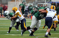 18 October 2014:  Erik Johnson tackles Anfernee Roberts during an NCAA division 3 football game between the Augustana Vikings and the Illinois Wesleyan Titans in Tucci Stadium on Wilder Field, Bloomington IL