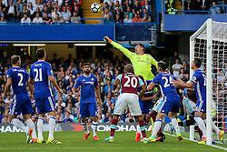 Thibaut Courtois of Chelsea punches clear - Rogan Thomson/JMP - 15/08/2016 - FOOTBALL - Stamford Bridge Stadium - London, England - Chelsea v West Ham United - Premier League Opening Weekend.
