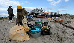 South Africa - Cape Town - 02 -October - 2020  Ntombothanda Tyimbela helped by her friend Pam Noluthando to try save what is left of her home.she came home to find the shack destroyed by strong winds that ravaged Cape Town since Thursday. she lost everything that was inside Photographer Ayanda Ndamane /African News Agency (ANA)