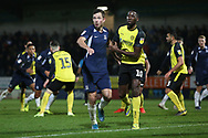 Tom Hopper and Lucas Akins tussle at a corner during the EFL Sky Bet League 1 match between Burton Albion and Southend United at the Pirelli Stadium, Burton upon Trent, England on 3 December 2019.