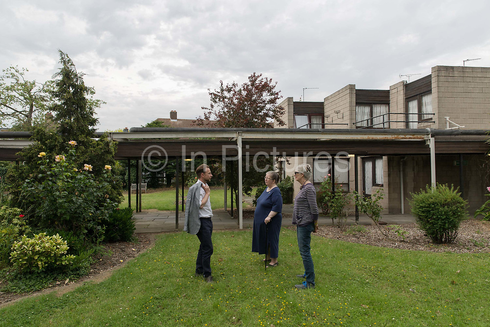 Architect Kate Macintosh visits 269 Leigham Court Road resident Deirdre Shaw to talk with Doug Black, Lambeth team leader for Conversation and Urban Design on 26th June 2015 in London, United Kingdom. 269 Leigham Court Road, built 1968 -1973, was designed as sheltered housing for older people by Kate Macintosh for the London Borough of Lambeth. In 2014, the low rise brutalist estate and architecturally important Grade II listed building, was faced regeneration plans.