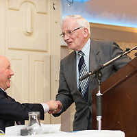 Outgoing president Tadgh Murphy shakes hands with new president Padraig MacMathuna