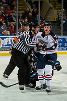 KELOWNA, CANADA - DECEMBER 5:  Linesman Josh Albinati gets between Kyle Olson #25 of the Tri-City Americans and a player of the Kelowna Rockets on December 5, 2018 at Prospera Place in Kelowna, British Columbia, Canada.  (Photo by Marissa Baecker/Shoot the Breeze)