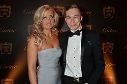 Jockey LUKE MORRIS and MADDI BISHOP PECK at the 26th Cartier Racing Awards held at The Dorchester, Park Lane, London on 8th November 2016.