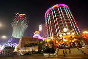The Grand Lisboa (left) and Lisboa (right) casinos stand in Macau, China, on February 22, 2008. Macao has overtaken Las Vegas with a gambling revenue of 7 billion U.S. dollars in 2006 (Las Vegas' was 6.6 billion U.S. dollars), and is now the world's top casino hut. Photo by Lucas Schifres/Pictobank