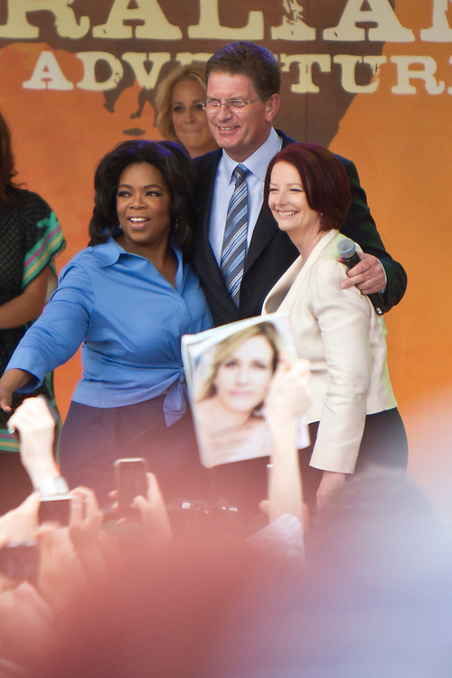 Oprah Winfrey, Victorian premier Ted Baillieu and Australian Prime Minister Julia Gillard wave to the 12,000 strong crowd during a public event at Federation Square on December 10, 2010 in Melbourne, Australia. Oprah Winfrey is in Australia with 302 audience members from the US, Canada and Jamaica and will tape episodes of the 25th and final season of 'The Oprah Winfrey Show' from the Sydney Opera house next week. The shows will air in the US and Australia in January 2011.