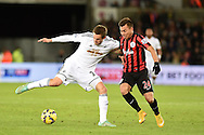 Gylfi Sigurdsson of Swansea city holds off Eduardo Vargas of QPR. Barclays Premier league match, Swansea city v Queens Park Rangers at the Liberty stadium in Swansea, South Wales on Tuesday 2nd December 2014<br /> pic by Andrew Orchard, Andrew Orchard sports photography.