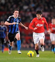 20120131: MANCHESTER, UK - Barclays Premier League 2011/2012: Manchester United vs Stoke City.<br /> In photo: Dean Whitehead of Stoke City chases after Park Ji-Sung of Manchester United.Barclays Premier League match between.<br /> PHOTO: CITYFILES