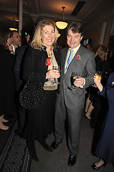 The EARL & COUNTESS OF CARNARVON at a party to celebrate the publication of 'Past Imperfect' by Julian Fellowes held at Cadogan Hall, 5 Sloane Terrace, London SW1 on 4th November 2008.