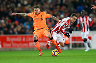 Alberto Moreno of Liverpool (l) tackles Xherdan Shaqiri of Stoke City. Premier league match, Stoke City v Liverpool at the Bet365 Stadium in Stoke on Trent, Staffs on Wednesday 29th November 2017.<br /> pic by Chris Stading, Andrew Orchard sports photography.