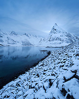 Volandstind mountain peak rises from sea near Fredvang bridges, Flakstadøy, Lofoten Islands, Norway