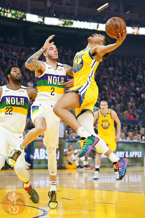 February 23, 2020; San Francisco, California, USA; Golden State Warriors guard Jordan Poole (3) shoots the basketball against New Orleans Pelicans guard Lonzo Ball (2) during the first quarter at Chase Center.