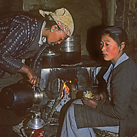 Sherpa women [Sherpanis] share yak butter tea by the wood stove in a house in Namche Bazaar, the leading town of Nepal's Khumbu region