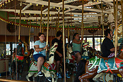 Coney Island's B&B Carousel, with its hand carved wooden horses, was built in 1906 and carefully restored using original techniques and materials, is on the National Register of Historic Places.