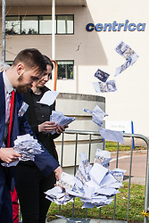 Windsor, UK. 22nd February, 2019. Activists playing Centrica managers count their money during a protest by around 60 campaigners from Reclaim the Power and Fuel Poverty Action who set up a mock fracking site outside the headquarters of Centrica to call on the British multinational energy and services company to cease its support for fracking operations through its partnership with shale gas company Cuadrilla Resources.