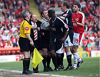Photo: Rich Eaton.<br /> <br /> Bristol City v Swansea City. Coca Cola League 1. 07/04/2007.Gary Johnson manager of Bristol City and Swanseas Dennis Lawrence #6 square up after Johnson enters the pitch to get the ball of Lawrence