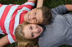 Portrait of teenage couple relaxing, smiling