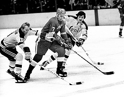 Detroit RedWing Red Berenson with Seals Stan Gilbertson and Carol Vadnais. (1971 photo/Ron Riesterer)
